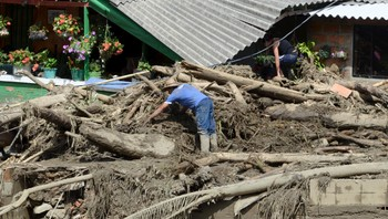 COLOMBIA-LANDSLIDE A man clears rubble from the ruins of his house, after a landslide sent mud and water crashing onto homes in the municipality of Salgar
