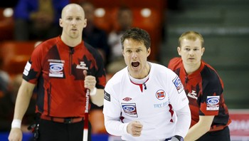 CURLING-WORLD/ Norway's skip Ulsrud calls a shot in front of Canada's lead Thiessen and second Rycroft during their page playoff 1-2 match at the World Men's Curling Championships in Halifax