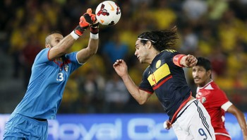 SOCCER-FRIENDLY/ Kuwait's goalkeeper Youssef tries to catch the ball as Falcao of Colombia jumps for the ball during their international friendly soccer match in Abu Dhabi