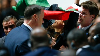 SOCCER-FIFA/ Security officers block a pro-Palestine protestor at the 65th FIFA Congress in Zurich