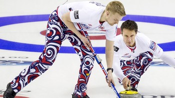 CURLING-WORLD/ Norway's skip Ulsrud delivers rock with lead Havard Vad Petersson during the eighth draw of the World Men's Curling Championships in Halifax