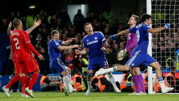 SOCCER-ENGLAND/LEAGUE Chelsea's Terry celebrates a goal against Liverpool scored by Ivanovic during their English League Cup semi-final second leg soccer match in London - JUBEL: Terry jubler over seiersmålet til Branislav Ivanovic. - Foto: STEFAN WERMUTH / Reuters