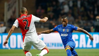 SOCCER-CHAMPIONS/ Monaco's Fabinho challenges Juventus Evra during their quarter-final second leg Champions League soccer match at the Louis II stadium in Monaco