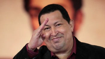 VENEZUELA-CHAVEZ/ Venezuelan President Hugo Chavez salutes after signing the new Labour Law during a national TV broadcast, ahead of May Day commemoration, in Caracas