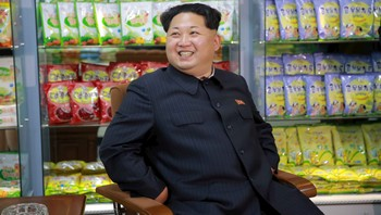 NORTHKOREA-KIM/ KCNA picture shows North Korean leader Kim Jong Un smiling while sitting during a visit to inspect the Pyongyang Children's Foodstuff Factory