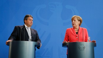 EUROZONE-GREECE/MERKEL German Chancellor Merkel and Economy Minister Gabriel address the media after a meeting of party leaders and faction heads at the Chancellery in Berlin