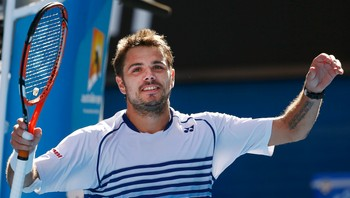 TENNIS-OPEN Wawrinka of Switzerland celebrates defeating Nishikori of Japan to win their men's singles quarter-final match at the Australian Open 2015 tennis tournament in Melbourne