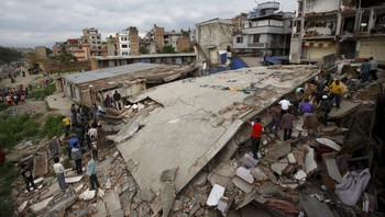 QUAKE-NEPAL/ People gather near a collapsed house after major earthquake in Kathmandu