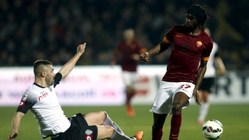 SOCCER-ITALY/ AS Roma's Gervinho is tackled by Cesena's Capelli during their Italian Serie A soccer match in Cesena