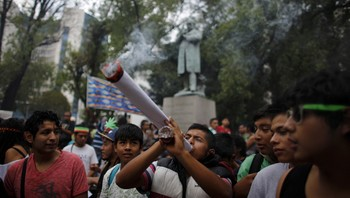 MEXICO-DRUGS/ File photo of a man smoking a big joint as his friends look on during a 420 dance party to demand legalisation and to celebrate marijuana culture outside the Senate building in Mexico City