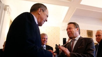 UKRAINE-CRISIS/LAVROV-NATO Russia's Foreign Minister Sergei Lavrov welcomes OSCE Parliamentary Assembly President Ilkka Kanerva before their meeting in Moscow
