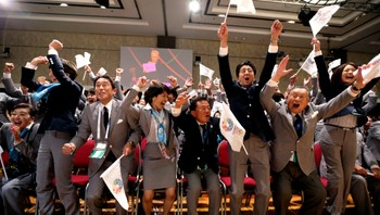 OLYMPICS-JAPAN-PROBLEMS File photo of Prime Minister Abe of Japan celebrating with members of the Tokyo bid committee as Rogge President of the International Olympic Committee announces Tokyo as the city to host the 2020 Summer Olympic Game during a ceremony in Buenos Aires