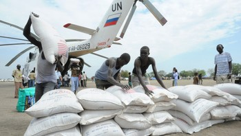 SUDAN Sacks of food are unloaded from a UN helicopter in Pibor