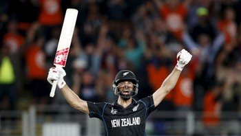 CRICKET-WORLD/SEMI-1 New Zealand's Grant Elliot reacts after hitting a shot for six runs to win their Cricket World Cup semi-final match against South Africa in Auckland