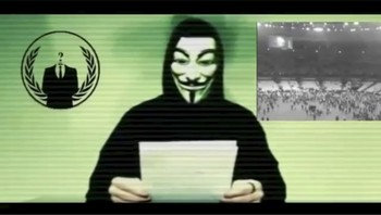 FRANCE-SHOOTING/ANALYSIS Still image from a video shows a man wearing a mask associated with Anonymous making a statement