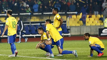SOCCER-COPA/M22 Brazil's players react after losing their penalty shootout to Paraguay in their Copa America 2015 quarter-finals soccer match at Estadio Municipal Alcaldesa Ester Roa Rebolledo in Concepcion