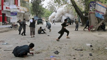 AFGHANISTAN-BLAST/ People run for cover after an explosion in Jalalabad