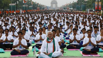 INDIA-YOGA/ India's PM Modi performs yoga with others during a camp to mark the International Day of Yoga, in New Delhi