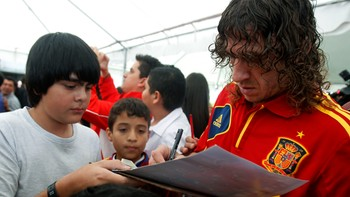 Spain's national soccer player Puyol signs autographs
