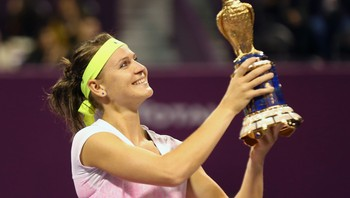 TENNIS-WOMEN/DOHA Safarova holds up her trophy after winning the women's singles final match at the Qatar Open tennis tournament in Doha