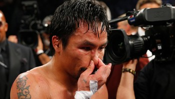 BOXING-WORLD/ Pacquiao of the Philippines reacts after losing to Mayweather, Jr. of the U.S. following their welterweight title fight in Las Vegas