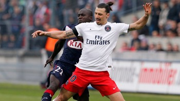 SOCCER-FRANCE/ Yambere of Bordeaux fights for the ball with Ibrahimovic of Paris St Germain during their French Ligue 1 soccer match at Chaban Delmas stadium in Bordeaux
