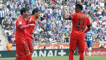SOCCER-SPAIN/ Barcelona's Lionel Messi celebrates his goal against Espanyol with teammates Luis Suarez and Neymar during their Spanish first division soccer match at Power8 stadium in Cornella de Llobregat near Barcelona
