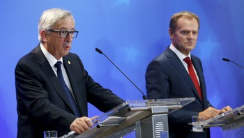 EUROPE-MIGRANTS/EU-SUMMIT EU Commission President Juncker and EU Council President Tusk address a joint news conference after a EU leaders extraordinary summit on the migrant crisis in Brussels