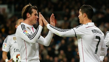 SOCCER-SPAIN/ Real Madrid's Gareth Bale celebrates his goal against Levante with teammate Cristiano Ronaldo during their Spanish First Division soccer match at Santiago Bernabeu stadium in Madrid