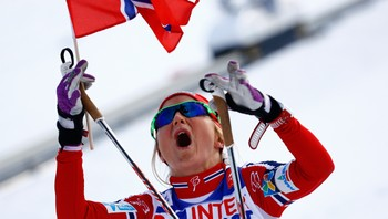 NORDIC-SKIING/ Norway's Johaug celebrates winning the women's cross country 30 km mass start classic race at the Nordic World Ski Championships in Falun