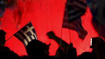 "EUROZONE-GREECE/ ""No"" supporters wave Greek national flags on the main Constitution (Syntagma) square in Athens, Greece"