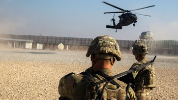 AFGHANISTAN-MILITARY/ U.S. soldiers from the 3rd Cavalry Regiment watch as a Blackhawk helicopter lands during a mission for Brigadier General Christopher Bentley to inspect an Afghan National police installation in the Nangarhar province of Afghanistan