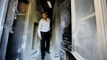 ISRAEL-PALESTINIANS/SEMINARY An Israeli man looks at damage at a Greek Orthodox seminary in Jerusalem