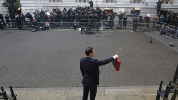 BRITAIN-BUDGET/ Britain's Chancellor of the Exchequer George Osborne holds his budget box up as he stands outside number 11 Downing Street in London