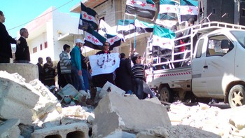 Antiregime-demonstranter i Homs i Syria.