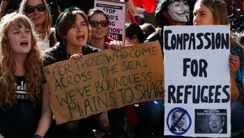 AUSTRALIA/ Demonstrators shout slogans against the government during a rally in support of asylum seekers in central Sydney