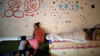 Israelis are seen in a bomb shelter in the Israeli southern city of Ashkelon
