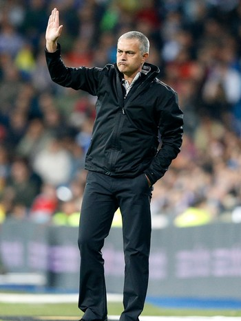 SOCCER-SPAIN/ Real Madrid's coach Jose Mourinho gestures during their Spanish First Division soccer match against Sporting Gijon in Madrid