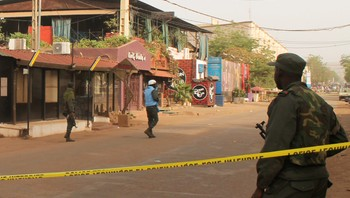 MALI-ATTACKS/ A soldier stands outside La Terrasse restaurant (top C) where militants killed five people, including a French citizen and a Belgian citizen, in a gun attack in Bamako