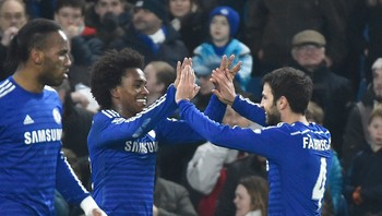 SOCCER-ENGLAND/ Willian (L) of Chelsea celebrates scoring against Everton with Cesc Fabregas during their English Premier League soccer match at Stamford Bridge, London