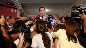 EUROZONE-GREECE/ELECTION Former Greek PM and leader of leftist Syriza party Tsipras speaks to journalists after he voted for the general election at a polling station in Athens