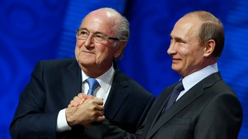 SOCCER-WORLD/DRAW FIFA's President Blatter shakes hands with Russia's President Putin during the preliminary draw for the 2018 FIFA World Cup at Konstantin Palace in St. Petersburg