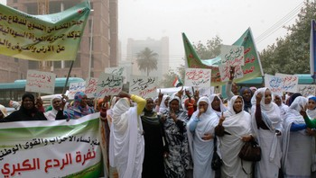 SUDAN/ Members of the Sudanese Women's Union demonstrate outside the U.N. building in Khartoum