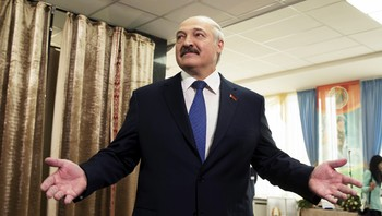 BELARUS-ELECTION/ Belarus' President Lukashenko, reacts after he casted his ballot during a presidential election at a polling station in Minsk