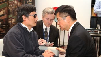 CHINA-USA/ A handout photo from U.S. Embassy Beijing Press office shows U.S. Ambassador to China Gary Locke holding blind activist Chen Guangcheng's hands as they talk in Beijing