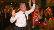 SOCCER-CHAMPIONS/ Bayern Munich coach Jupp Heynckes dances together with midfielder Bastian Schweinsteiger at the team's banquet in London