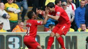 SOCCER-ENGLAND/ Liverpool's Raheem Sterling celebrates his 2nd goal against Norwich City with Luis Suarez during their English Premier League soccer match at Carrow Road in Norwich