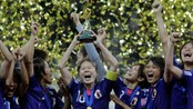 SOCCER-WORLD/ Japan&#39;s players celebrate with the trophy after winning their Women&#39;s World Cup final soccer match against the U.S. in Frankfurt