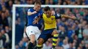 SOCCER-ENGLAND/ Everton's McCarthy challenges Arsenal's Ozil during their English Premier League soccer match at Goodison Park in Liverpool