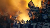 SOCCER-FRANCE/ Supporters of Olympique Marseille attend their French Ligue 1 soccer match against Olympique Lyon at the Gerland stadium in Lyon